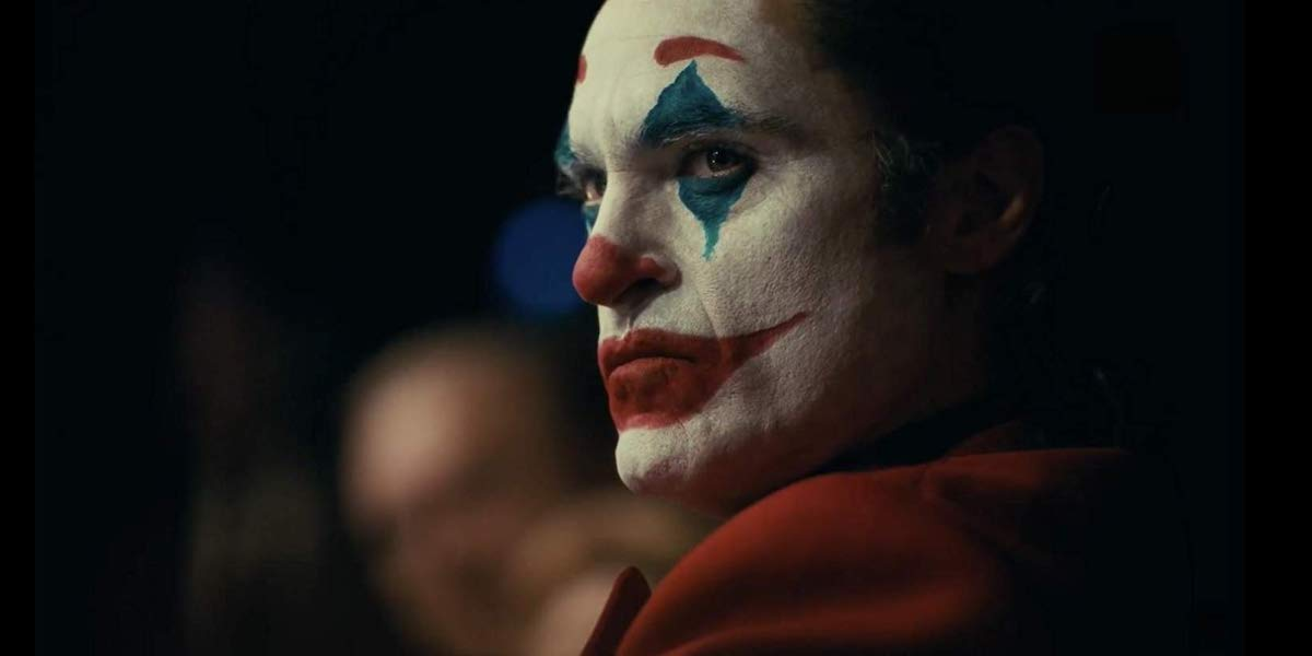 Joaquin Phoenix as Joker in clown makeup