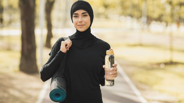 Easy ways to drink more water include investing in a reusable bottle and using smart tech