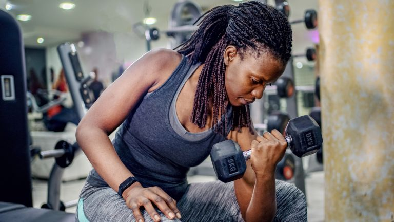 Woman performing a dumbbell arms workout