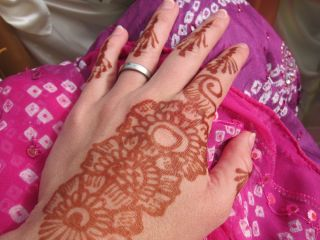 Henna design on hand at Indian wedding