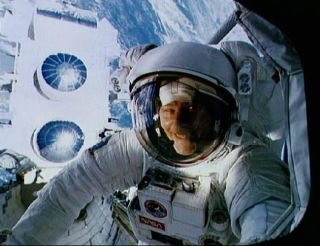 Astronaut Jerry Ross smiles for a quick photo during the first spacewalk of the shuttle mission STS-37 in April 1991.