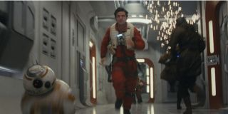 Oscar Isaac and BB8 running in Star Wars: The Last Jedi