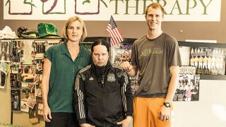 A photograph of Joey Jordison with his therapists at Absolute Performance Therapy