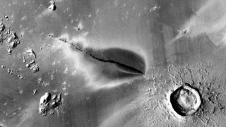 A satellite image of a recent explosive volcanic deposit around a fissure of the Cerberus Fossae system on Mars.