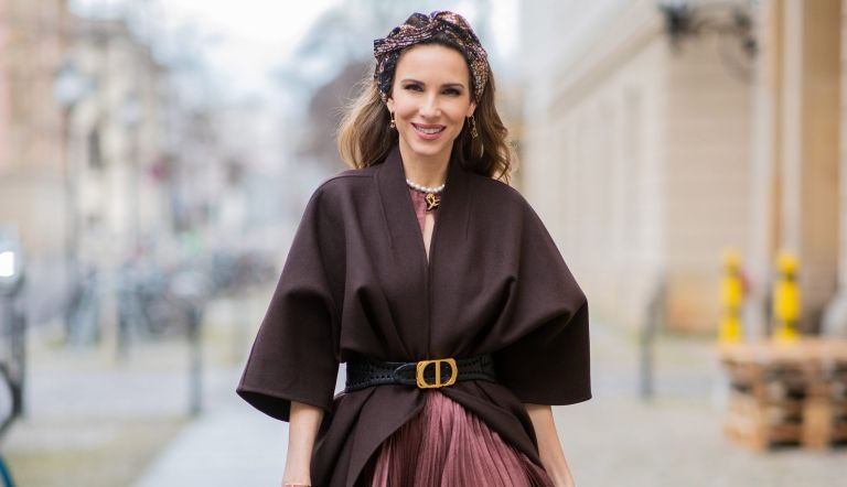 Alexandra Lapp is seen wearing Dior Cruise 2020 collection dress an example of what to wear to a winter wedding