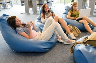 Teen girls at the library online.
