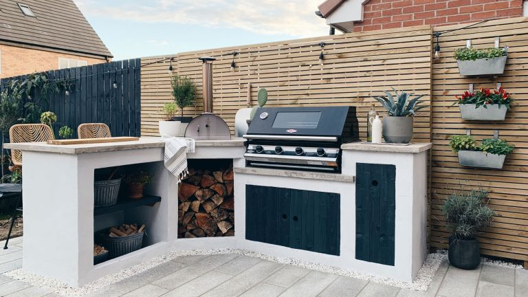blue outdoor kitchen with bar stools