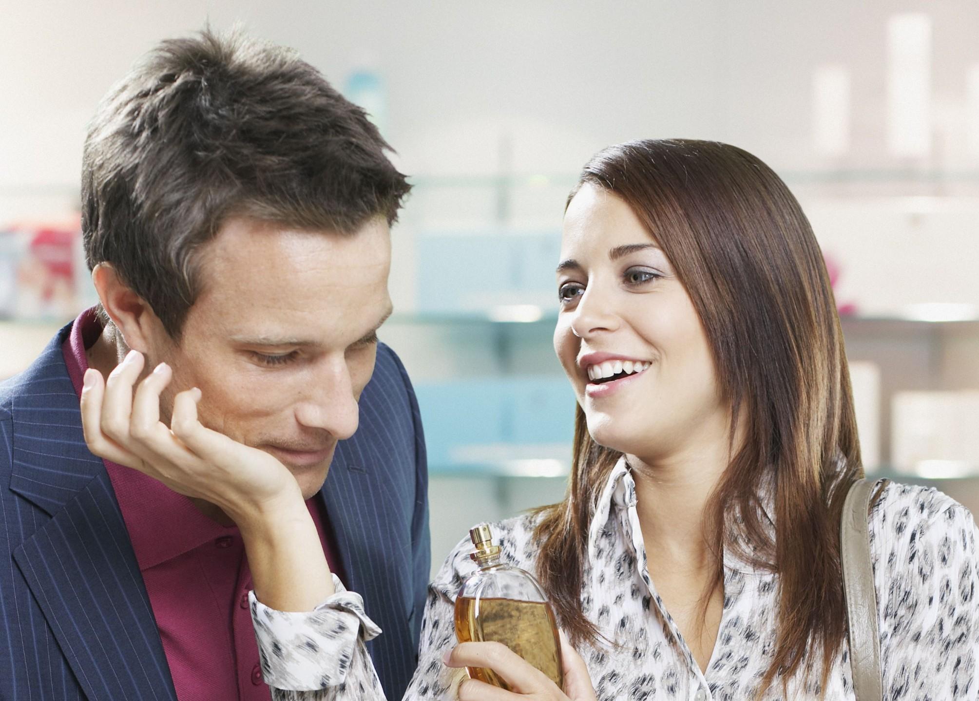 couple smelling perfume
