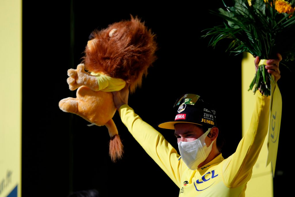 Team Jumbo rider Slovenias Primoz Roglic celebrates his overall leader yellow jersey on the podium at the end of the 12th stage of the 107th edition of the Tour de France cycling race 218 km between Chauvigny and Sarran on September 10 2020 Photo by STEPHANE MAHE POOL AFP Photo by STEPHANE MAHEPOOLAFP via Getty Images
