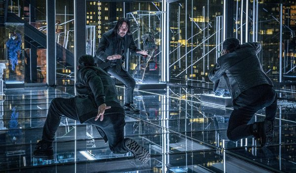 John Wick: Chapter 3 John fights two combatants in The Continental's glass office.