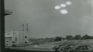 """On July 16, 1952, Coast Guard seaman Shell Alpert took this photo of four roughly elliptical blobs of light in formation through the window of his photographic laboratory near Salem, Massachusetts. The U.S. Air Force's UFO task force, Project Blue Book, investigated the image and deemed it """"unexplained."""""""