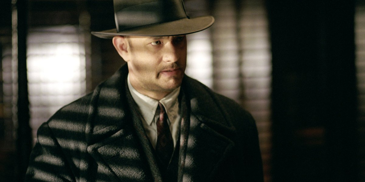 Road To Perdition Tom Hanks looking grim in a suit and overcoat