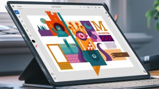 Tablet-laptop hybrid on desk, with abstract graphics created in Adobe Illustrator on its screen