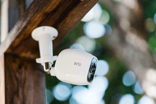 Arlo security camera mount under outdoor beam