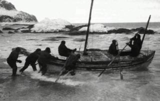 Legendary explorer Ernest Shackleton and his men boarding the boat that would take them to South Georgia.