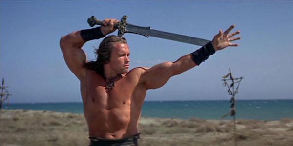Arnold Schwarzenegger wielding sword as Conan the Barbarian