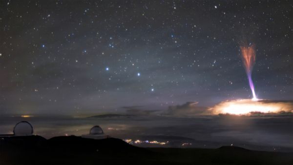 Uncommon purple sprite and blue jet create otherworldly gentle present above Hawaii