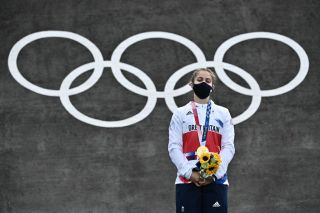 Britains Bethany Shriever stands on the podium for the victory ceremony for the cycling BMX racing womens event at the Ariake Urban Sports Park during the Tokyo 2020 Olympic Games