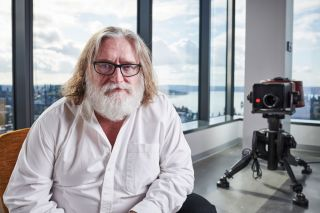Gabe Newell sitting in an office building