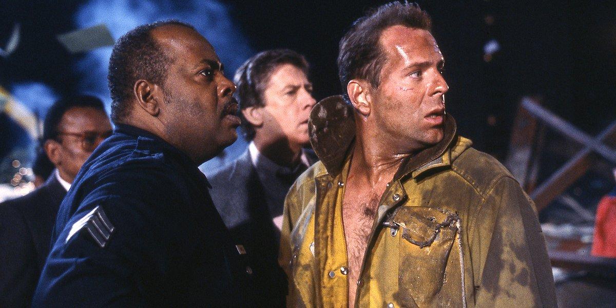Reginald VelJohnson and Bruce Willis in Die Hard