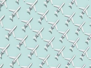 Pattern made of airplanes representing black friday flight deals