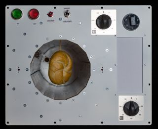 Oven that bakes in Microgravity
