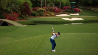 Justin Rose of England tees off on No. 12 on Thursday, April 8, 2021, at The Masters in Augusta, Ga.