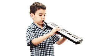 A child playing a melodica