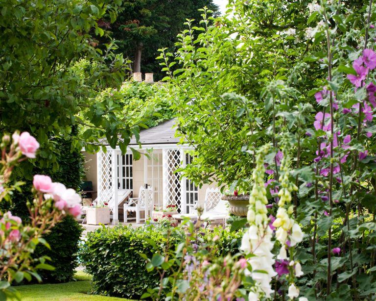 English garden ideas with foxgloves and garden room