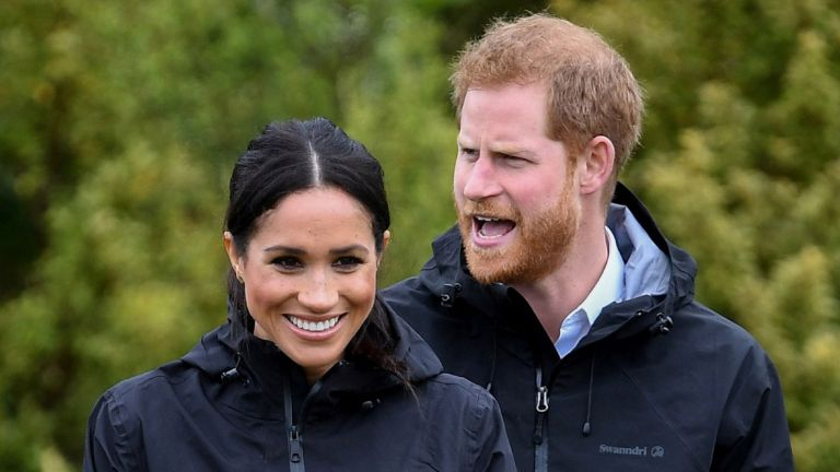 Podcasting: Meghan, Duchess of Sussex participates in wellie wanging with Prince Harry, Duke of Sussex as they visit the North Shore