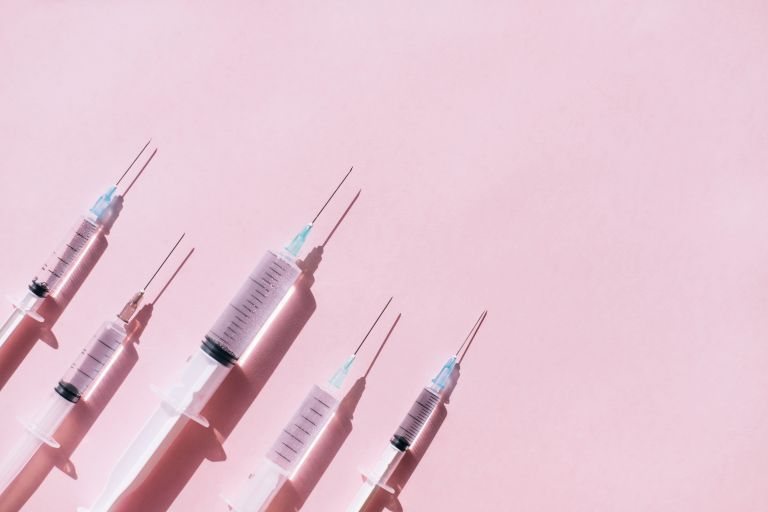 pink background with four botox needles