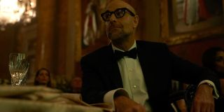 A Private War Stanley Tucci in a tuxedo, sitting at a table
