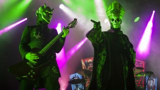 A photograph of Papa Emeritus and a Nameless Ghoul on stage