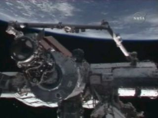 Space Station Astronauts Move Shuttle Docking Port