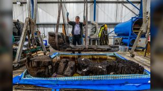 Ian Panter, head of conservation at York Archaeological Trust, examines the Bronze Age coffin.