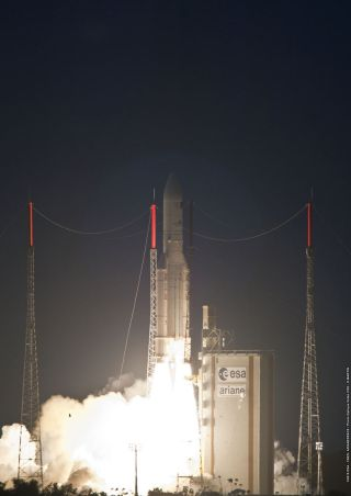 An Arianespace Ariane 5 rocket soars from a launch pad at the Guiana Space Center Kourou, French Guiana on Dec. 29, 2010, carrying two new communications satellites for different customers