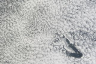 Swirling clouds near Saint Helena, an island in the South Atlantic Ocean, as photographed by NASA's Terra satellite on Nov. 15, 2012.