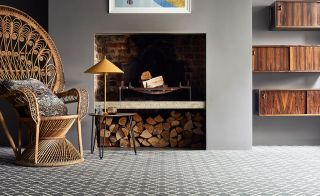 In this example a log store has been built in as part of the open fireplace design