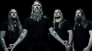 Amon Amarth standing in front of a black background