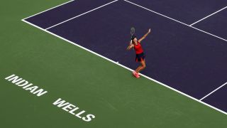 Female tennis player serving during Indian Wells tournament