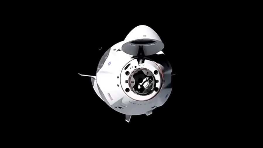 SpaceX Crew Dragon capsule docks at space station with its 1st crew of 4