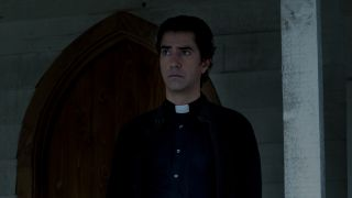 father pruitt standing outside church on midnight mass