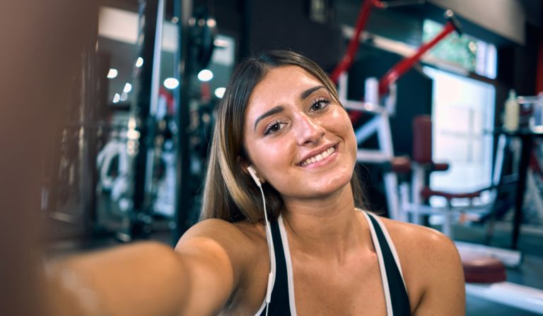 Woman taking a selfie in the gym