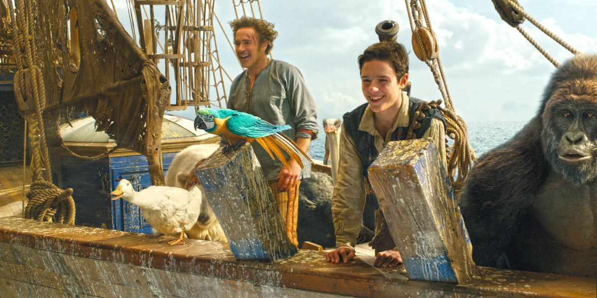 Robert Downey Jr and animals on a ship in Dolittle, including Rami Malek as Chee Chee the Gorilla