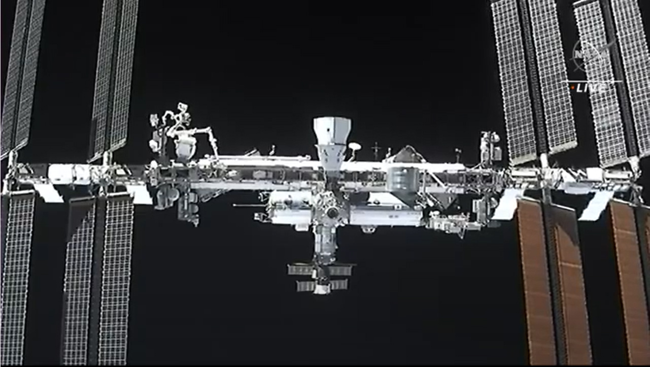 The International Space Station and SpaceX's Crew-1 Crew Dragon spacecraft Resilience (top) can be seen in this camera view from the Crew-2 Dragon Endeavour during docking operations on April 24, 2021.