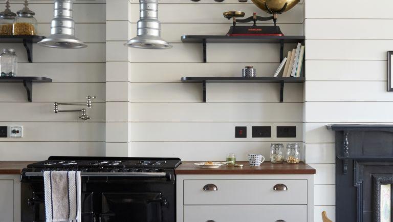 Pot filler taps trend in a white wooden kitchen