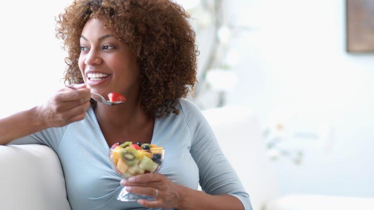 Woman eating for better skin