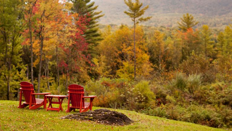 Adirondack chairs looking out over vista in Vermont USA