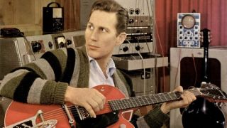 Chet Atkins pictured in the studio with his Gretsch 6119 Tennessean signature model