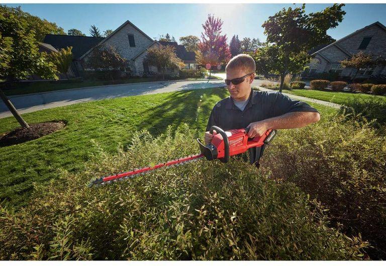 Man using MILWAUKEE hedge trimmer